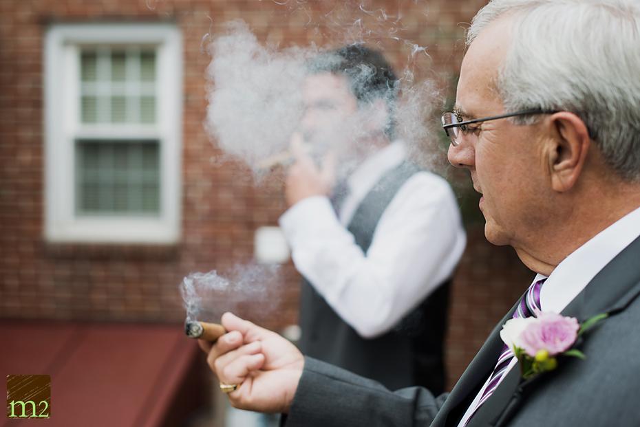grooms dad smoking cigar