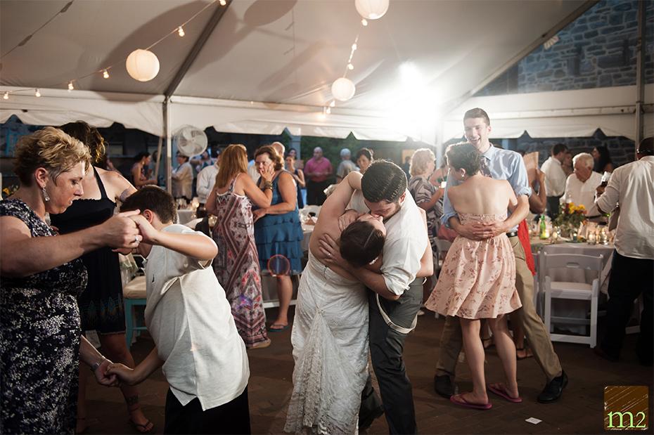 Groom dipping bride on dancefloor