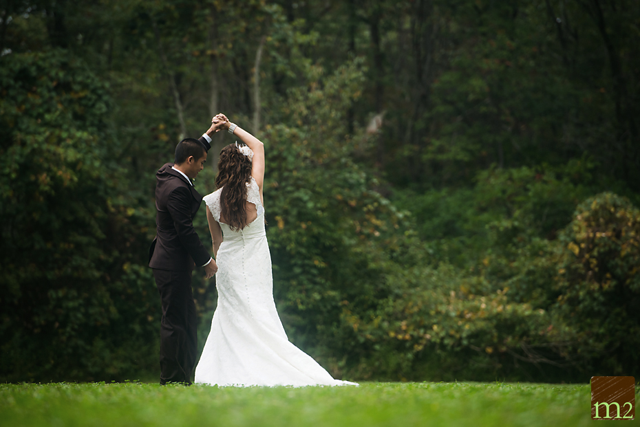 Bride and groom in open field