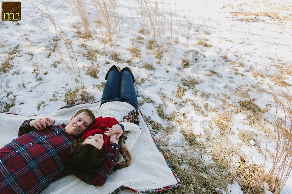 laying-in-snow-winter-engagement